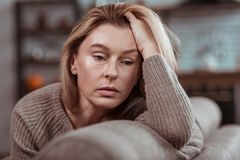 Pleasant appealing woman feeling depressed after divorce royalty free stock photo