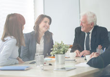 Pleasant atmosphere during business conference. Pleasant and kindly atmosphere during business conference stock images