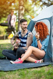 Pleasant atmosphere at summer camp with music and guitar Stock Photos