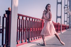 Free Pleasant Attractive Ballerina Standing With A Flower Royalty Free Stock Images - 127814839