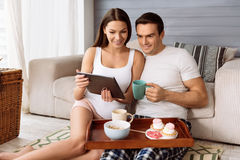 Pleasant attractive woman showing something on the tablet Royalty Free Stock Photos