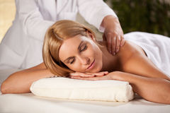 Pleasant back massage Stock Images