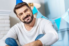 Pleasant bearded man celebrating a party Royalty Free Stock Images