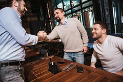 Pleasant bearded man greeting his friend Stock Image