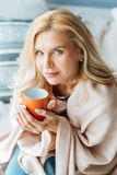 Pleasant beautiful woman drinking tea at home Royalty Free Stock Images