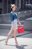 Pleasant beautiful woman having a walk Stock Images