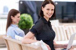 Pleasant beautiful woman sitting on the couch Royalty Free Stock Images