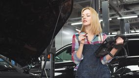 Pleasant blond girl using an automotive diagnostic scanner.  stock video