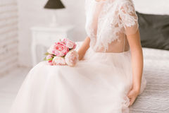 Pleasant bride holding the wedding bouquet Royalty Free Stock Photography