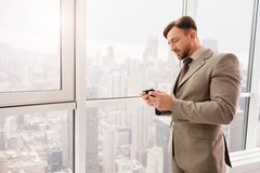 Pleasant businessman resting in his office Stock Photo