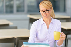 Pleasant businesswoman sitting at the table Stock Image
