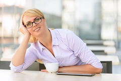 Pleasant businesswoman sitting at the table Stock Photo