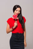 Pleasant charming woman holding lollypop Royalty Free Stock Photos