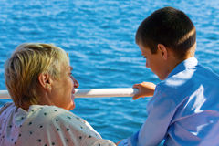 Pleasant chat. Pleasant conversation between grandmother and grandchild on shipboard Royalty Free Stock Photography