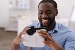 Pleasant cheerful man holding 3d glasses Stock Photography