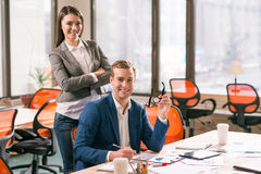 Pleasant colleagues expressing gladness in the office Royalty Free Stock Images