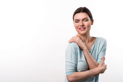 Pleasant content girl standing on white background Royalty Free Stock Photo
