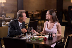 Pleasant couple communicating in the restaurant Royalty Free Stock Images