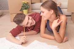 Pleasant couple drawing plan Royalty Free Stock Photo