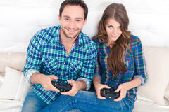 Pleasant couple playing video games Stock Image