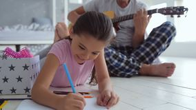 Pleasant creative girl drawing at home stock footage