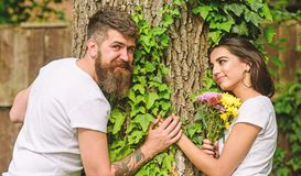 Pleasant date in nature environment. Man bearded hipster holds hand girlfriend. Couple in love romantic date walk nature. Tree background. Couple in love lean stock image