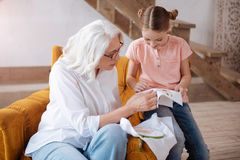 Pleasant delighted woman teaching to embroider Royalty Free Stock Images