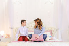 Pleasant display of attention from small son for mom in form of Stock Photos