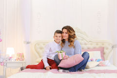 Pleasant display of attention from small son for mom in form of Stock Photography