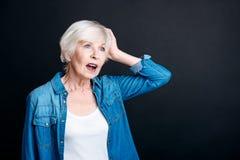 Pleasant elderly woman having an idea Stock Photos