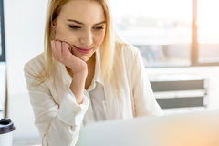 Pleasant elegant girl working at light office Stock Image