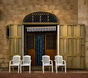 A pleasant evening. Malta. The courtyard is near the Maltese house. Chairs for outdoor recreation. Blind on the door Stock Images