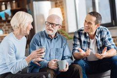 Pleasant family drinking tea and socializing Royalty Free Stock Photo