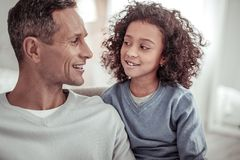 Pleasant father and cute daughter looking at each other royalty free stock photos