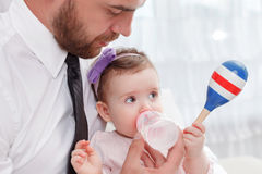 Pleasant father feeding baby Stock Photos