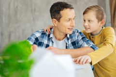 Pleasant father and son bonding in the office Royalty Free Stock Photo