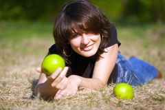 The pleasant girl with an apple Stock Photos