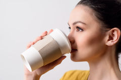 Pleasant girl drinking coffee Stock Photo