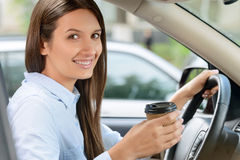 Pleasant girl driving a car royalty free stock images