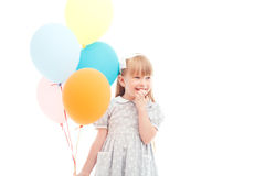 Pleasant girl holding balloons Royalty Free Stock Photo