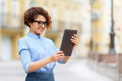 Pleasant girl holding laptop. Be positive. Nice attractive blissful girl holding laptop and looking at it while expressing joy Royalty Free Stock Images