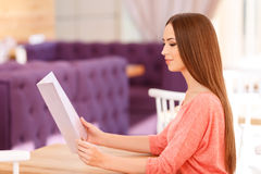 Pleasant girl holding menu Stock Photo