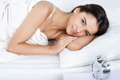 Pleasant girl lying in bed Royalty Free Stock Image