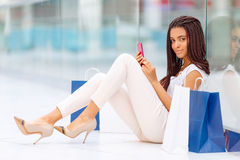 Pleasant girl making shopping Stock Photography