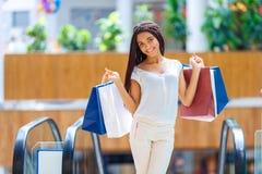 Pleasant girl making shopping Royalty Free Stock Image
