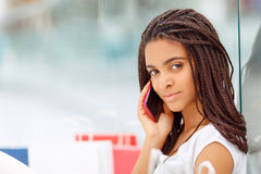 Pleasant girl making shopping Stock Image