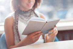 Pleasant girl reading book Royalty Free Stock Images