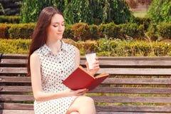 Pleasant girl reading book Royalty Free Stock Photos