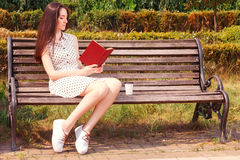 Pleasant girl reading book Stock Images