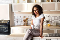 Pleasant girl resting in the kitchen Stock Photos